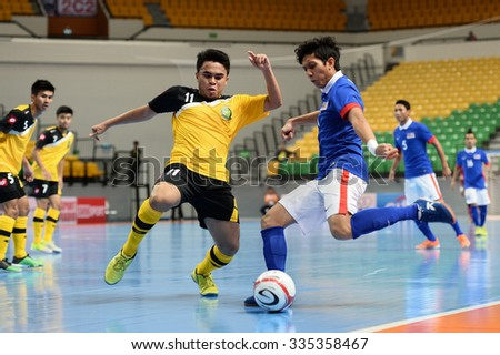 BANGKOK THAILAND-OCT8:Qaiser(R) of Malaysia in action during 2015 AFF Futsal Championship Match between Brunei Darussalam and Malaysia at Bangkok Arena Stadium on October8,2015 in Thailand