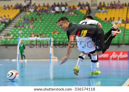 BANGKOK THAILAND-OCT9: Sarmento of Timor Leste  in action during 2015 AFF Futsal Championship Match between Timor Leste and Brunei Darussalam at Bangkok Arena Stadium on October9,2015 in Thailand