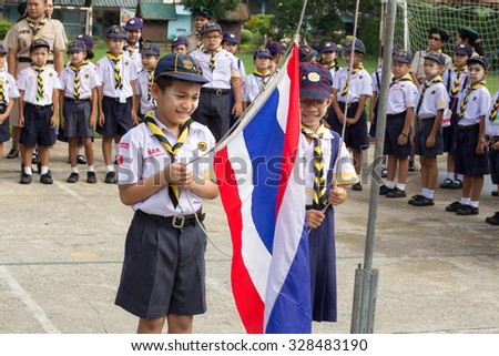 BANGKOK, THAILAND - Oct 6, 2015 : Student 9-10 years old, Scout sang the national anthem, Scout Camp in Pieamsuwan school Bangkok Thailand.
