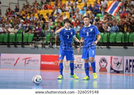 BANGKOK THAILAND-OCT9:Suphawut Thueanklang(No.9) of Thailand in action during 2015 AFF Futsal Championship Match between Thailand and Singapore at Bangkok Arena Stadium on October9,2015in Thailand