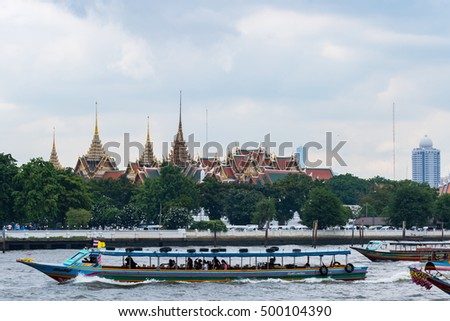 Bangkok, Thailand - OCT 10, 2016: Temples and tourists at Bangkok's Grand Palace. The Grand Palace is made up of various buildings, halls and pavilions.