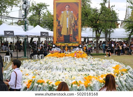 Bangkok-Thailand OCT 21, 2016: Thai people are wearing black to pay respect for the King Bhumibol Adulyadej at Sanam Luang field in front of Grand Palace on OCT 21, 2016 Bangkok Thailand.