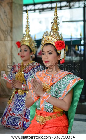 BANGKOK, THAILAND - OCT 22, 2015. Thai women dressed as goddess to show Thai Folk Dance at the temple in Bangkok, Thailand on End of Buddhist Lent Day. - stock photo