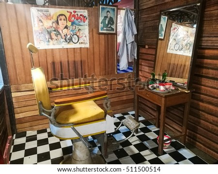 BANGKOK, THAILAND - OCTOBER 21, 2016: antique Thai barber with retro chair and old table.