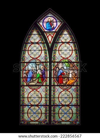 BANGKOK, THAILAND - OCTOBER 5, 2014: Catholic stained glass at Holy Rosary Church. The unique art in this church, October 5, 2014 in Bangkok, Thailand.  Isolated on black background