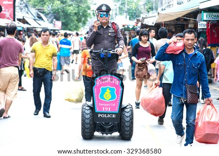 BANGKOK THAILAND -OCTOBER 18 Chatuchak Weekend Market Police tourists check out the safety of tourists.The product went on the market with its gas scooter Instead of patrolling by foot OVTOBER 18,2015 - stock photo