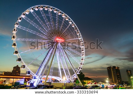BANGKOK THAILAND - OCTOBER 29 : Ferris Wheel  in ASIATIQUE The Riverfront at twilight time , on October 29, 2015 in Bangkok, Thailand. - stock photo