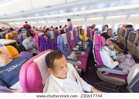 BANGKOK, THAILAND - OCTOBER 27: flight crew and passengers on board an Thai Airways flight from Suvarnabhumi Airport to Yangoon Airport on October 27, 2014 - stock photo