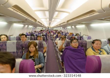 BANGKOK, THAILAND - OCTOBER 1: flight crew and passengers on board an Thai Airways flight from Suvarnabhumi Airport to Yangoon Airport on October 1, 2015 - stock photo