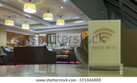 BANGKOK, THAILAND - OCTOBER 3, 2015: Free Wireless Internet Wifi Sign with Out of Focus King Power VIP Executive Business Lounge background at Suvarnabhumi Airport