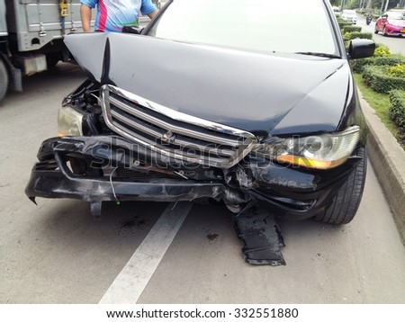 Bangkok, THAILAND - OCTOBER 28 : Front side of black private car damaged after get heavy on the  road accident on october 28  , 2015 in Bangkok, Thailand.