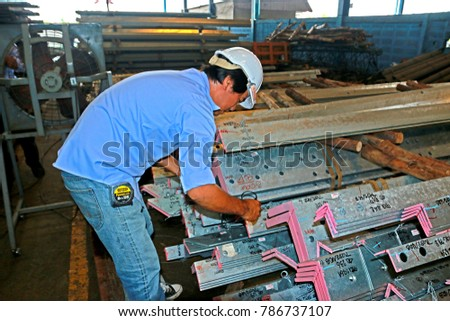 BANGKOK-THAILAND-OCTOBER 4 : Hot-dip galvanized steel member for steel tower in transmission line before shipment, October 4, 2016 Bangkok, Thailand