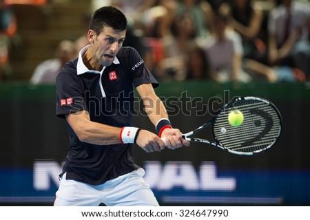 BANGKOK THAILAND OCTOBER 02:Novak Djokovic of Serbia returns a backhand during the Black to Thailand Nadal vs Djokovic exhibition match at Hua Mark Indoor Stadium on Oct 2, 2015 in,Thailand. - stock photo