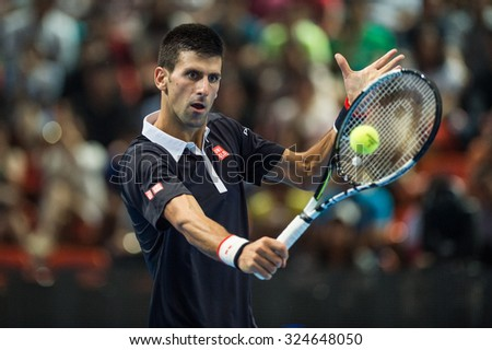 BANGKOK THAILAND OCTOBER 02:Novak Djokovic of Serbia returns a backhand during the Black to Thailand Nadal vs Djokovic exhibition match at Hua Mark Indoor Stadium on Oct 2, 2015 in,Thailand. - stock photo