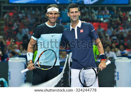 BANGKOK THAILAND OCTOBER 02:Rafael Nadal  (L) and Novak Djokovic pose during the Black to Thailand Nadal vs Djokovic exhibition match at Hua Mark Indoor Stadium on Oct 2, 2015 in,Thailand. - stock photo