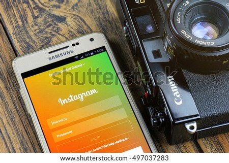 BANGKOK, THAILAND - 7 OCTOBER 2016: Samsung A5 Smartphone close up display instagram application on the screen and Canon A35 vintage film camera, Instagram is a photo-sharing app for smartphone.