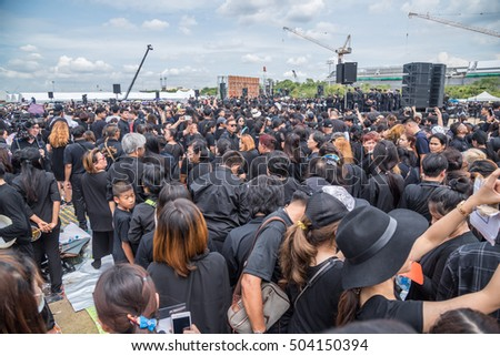 Bangkok, Thailand - October 22,2016 :Thai people come for singing the anthem of His Majesty King Bhumibol at Sanam Luang in front of the Royal Palace to pay respect for the king in Bangkok,Thailand.