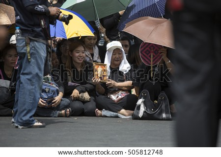 Bangkok, Thailand - October 22,2016 :Thai people singing the anthem for King Bhumibol in front of the Royal Palace to pay respect in Bangkok,Thailand.