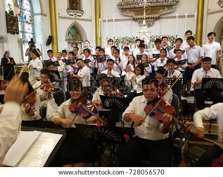 BANGKOK - THAILAND, October 1,2017 : The catholic youth band playing the music in the catholic mass to celebrate the church in occasion of anniversary 120th years at Sampantawong in Bangkok Thailand.