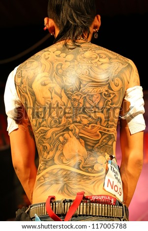 "BANGKOK, THAILAND - OCTOBER 23: Unidentified contestant's tattoo at MBK Center ""MBK TATTOO CONTEST 2012"" on October 23, 2012 in Bangkok, Thailand"