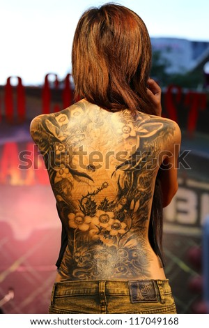 """BANGKOK, THAILAND - OCTOBER 23: Unidentified contestant's tattoo at MBK Center """"MBK TATTOO CONTEST 2012"""" on October 23, 2012 in Bangkok, Thailand - stock photo"""
