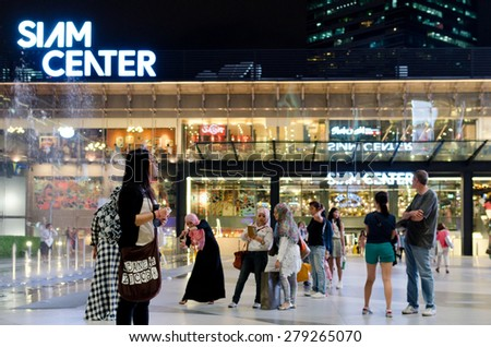 BANGKOK, THAILAND - OCTOBER 21 : Unidentified people walk at Siam Center shopping mall on 21 October, 2013 in Bangkok, Thailand
