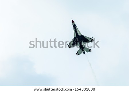 Bangkok, Thailand - October 9, 2009: United States Air Force Thunderbirds official military aerobatic team during an exhibition. Cooperation between by RTAF with USAF. at RTAF Base, Bangkok, Thailand