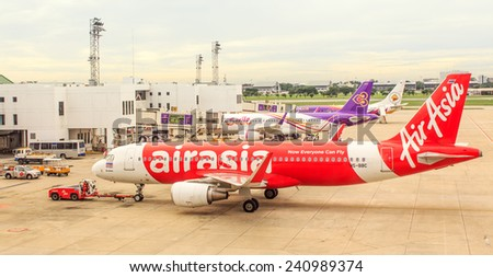 Bangkok, Thailand - Sep 19, 2014. Aircraft of Air asia Airlions, thaismile Airlines, nok airlines are parking and preparing to flying at Donmueang Airport on Sep 19,2014 - stock photo