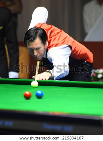 Bangkok, Thailand - SEP 5: Dominic Dale of Wales in action during Sangsom Six-red World Championship 2014 at Montien Riverside Hotel on September 5, 2014 in Bangkok, Thailand.