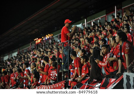BANGKOK THAILAND-SEP18:Football fanclub of Muangthong United in action during Toyota League Cup between Mtutd(R) and Chonburi Fc(B) at Yamaha Stadium on September18, 2011 Bangkok Thailand