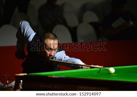 BANGKOK,THAILAND-SEP 3,2013: James Wattana player of Thailand in action during Snooker 6-Red World Championship 2013 at Montien Riverside? hotel on September 3,2013 in Bangkok, Thailand