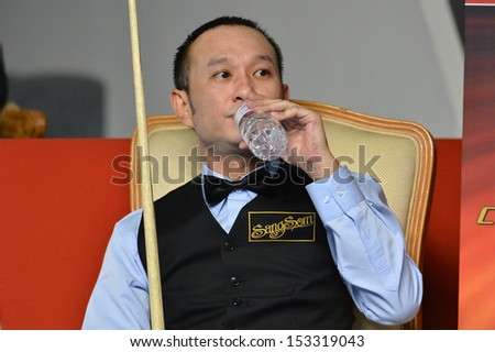 BANGKOK,THAILAND-SEP 3,2013: James Wattana player of Thailand in action during Snooker 6-Red World Championship 2013 at Montien Riverside hotel on September 3,2013 in Bangkok, Thailand