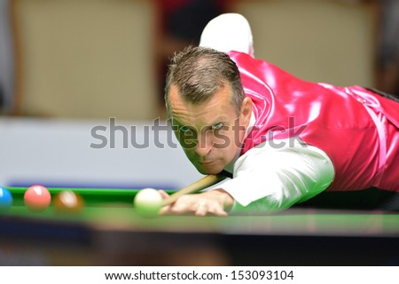 BANGKOK,THAILAND-SEP 6,2013: Mark Davis player of England in action during Snooker 6-Red World Championship 2013 at Montien Riverside? hotel on September 6,2013 in Bangkok, Thailand