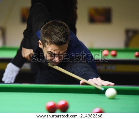 Bangkok, Thailand - SEP 4:Michael Holt of England in action during Sangsom Six-red World Championship 2014 at Montien Riverside Hotel on September 4, 2014 in Bangkok, Thailand.