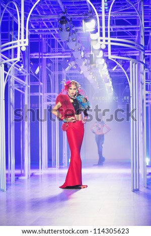 "BANGKOK, THAILAND - SEP 29 : Model walks the runway at ""Frederick Lee "" collection presentation during Siam Paragon International Couture Fashion Week 2012 on September 29, 2012 in Bangkok Thailand."