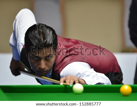 Bangkok, Thailand - SEP 2:Muhammad Asif of Pakistan participates in a Sangsom Six-red World Championship 2013 at Montien Riverside Hotel on September 2, 2013 in Bangkok, Thailand.