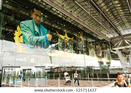 BANGKOK, THAILAND - SEPTEMBER 9: Building of Bangkok International Airport and tourists on September 9, 2010 in Bangkok, Thailand. More then 16 mln tourists is expected to visit Thailand in year 2010.