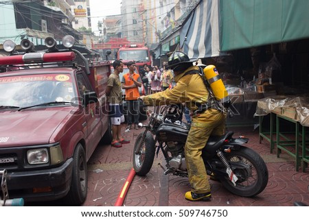 BANGKOK, THAILAND - SEPTEMBER 26, Fire Fighter ride on motorcycle at Market in Yaowarat China Town Bangkok, Thailand.