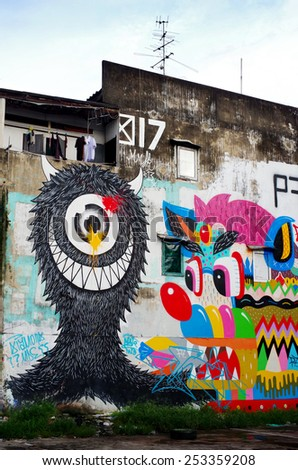 BANGKOK, THAILAND - 21 SEPTEMBER: Giant graffiti on abandoned building of Bangkok on September 21, 2013 in Bangkok, Thailand - stock photo