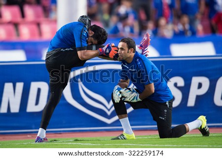 BANGKOK,THAILAND SEPTEMBER 08:Goalkeeper Noor Sabri no.22 (L)of Iraq  for the ball during the 2018 FIFA World Cup Qualifier between Thailand and Iraq at Rajamangala Stadium on Sep 8, 2015 in Thailand. - stock photo