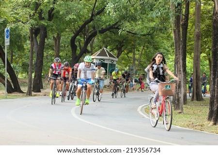 BANGKOK THAILAND -September 24- group of bikers are riding bikes in bicycle lanes of at the Vachirabenjatas Park (Rot Fai park) of Bangkok on September 24 ,2014 in Bangkok, Thailand  - stock photo
