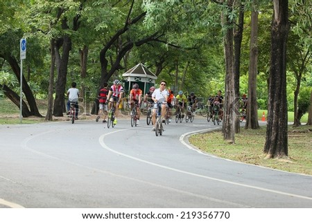 BANGKOK THAILAND -September 24- group of bikers are riding bikes in bicycle lanes of at the Vachirabenjatas Park (Rot Fai park) of Bangkok on September 24 ,2014 in Bangkok, Thailand