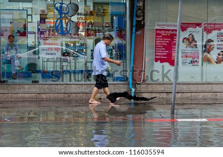 BANGKOK, THAILAND - SEPTEMBER 25: Heavy storm hit Bangkok and created a flood in the middle of the city on September 25, 2012. Bangkok - stock photo