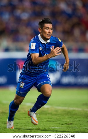 BANGKOK,THAILAND SEPTEMBER 08:Kroekrit Thaweekarn of Thailand in action during the 2018 FIFA World Cup Qualifier between Thailand and Iraq at Rajamangala Stadium on Sep 8, 2015 in Thailand. - stock photo