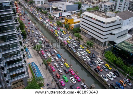 BANGKOK, THAILAND - SEPTEMBER 8: Many car stuck in traffic jam crowded on September 8,2016 in Sathorn, Bangkok, Thailand. Shot from top of building