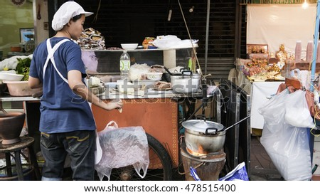 Bangkok,Thailand - September 3, 2016: Night market for Chef cooking on chinatown (Yaowarat) Road,the main street in Chinatown,once of Bangkok landmark for more foods thai-chinese style very delicious.