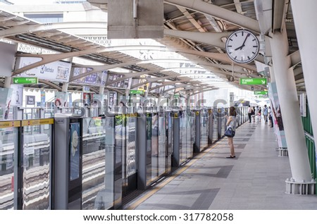 BANGKOK, THAILAND - September 15, 2015 : People wait for the sky train in central Bangkok in Bangkok, Thailand.