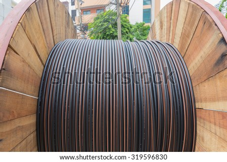 BANGKOK - THAILAND - SEPTEMBER 17 :Telephone wire in wooden roll on sidewalk on September 17,2015 Bangkok, Thailand