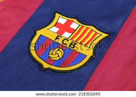 BANGKOK, THAILAND -SEPTEMBER 19, 2014: the logo of Barcelona football club on an official jersey on 19 September 2014 in Bangkok Thailand. - stock photo