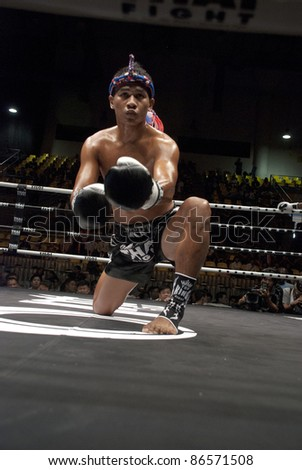 BANGKOK, THAILAND- SEPTEMBER 25 : Unidentified fighter in Thai Fight:Muay Thai. World's Unrivalled Fight on September 25, 2011 at Thammasat University Convention Center, Bangkok, Thailand - stock photo